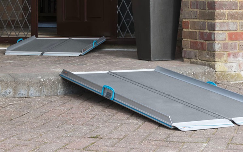 Folding ramps laid out leading to front door of house